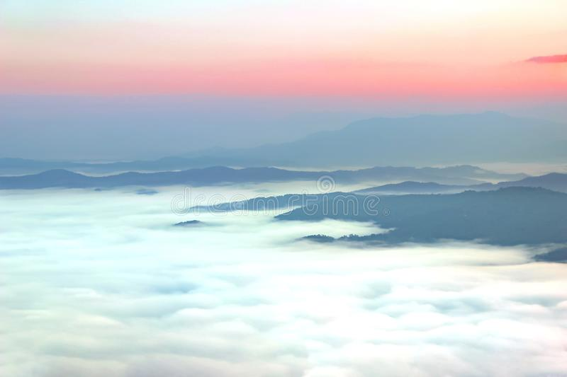 Morning scene, beauty summer foggy image, attractive view of valley covered fog on background gold sunlight, fantastic mountains l stock image