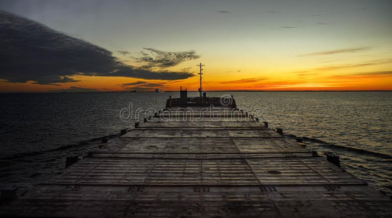 Morning at sea. View from navigational bridge.Begining of new day. Warm lights. royalty free stock image