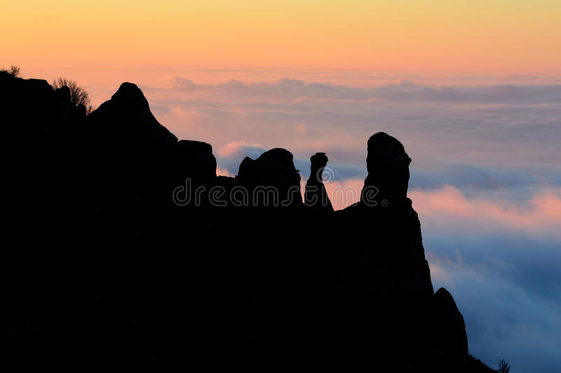 Morning silhouette. Silhouette of rocks in sunlit clouds at sunrise, Crimea royalty free stock images