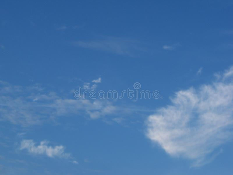 Bright blue sky with a few clouds. Morning sky, bright blue with a few clouds stock photos