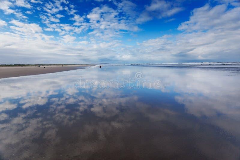 Morning sky, Long Beach. Morning sky over wide wet sands of Long Beach, Washington royalty free stock photos