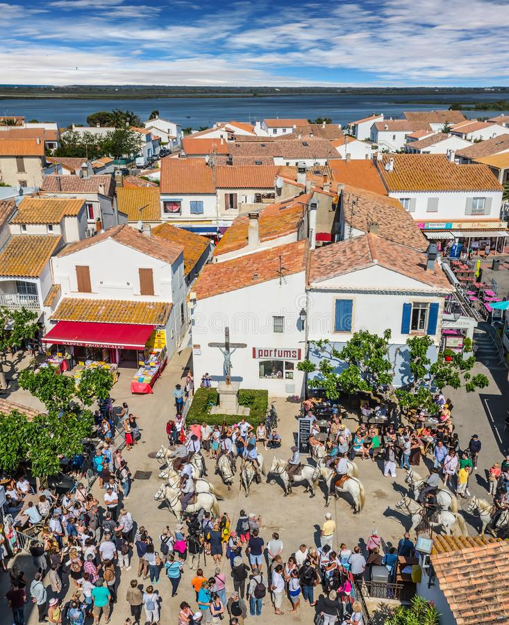 Morning of the spring carnival. The concept of ethnographic tourism. Morning of the spring religious carnival. Provencal city Saintes-Maries-de-la-Mer stock photo