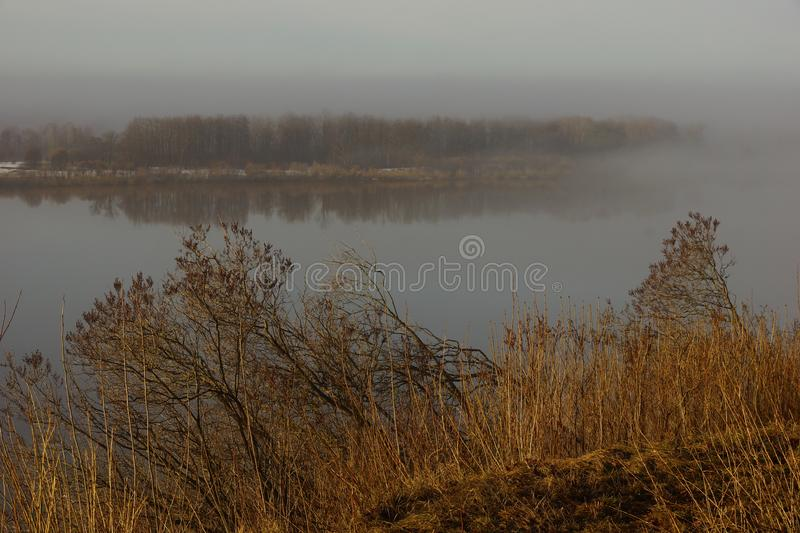 Morning spring fog over the river rises the sun is melting snow. Beautiful scenery royalty free stock photos