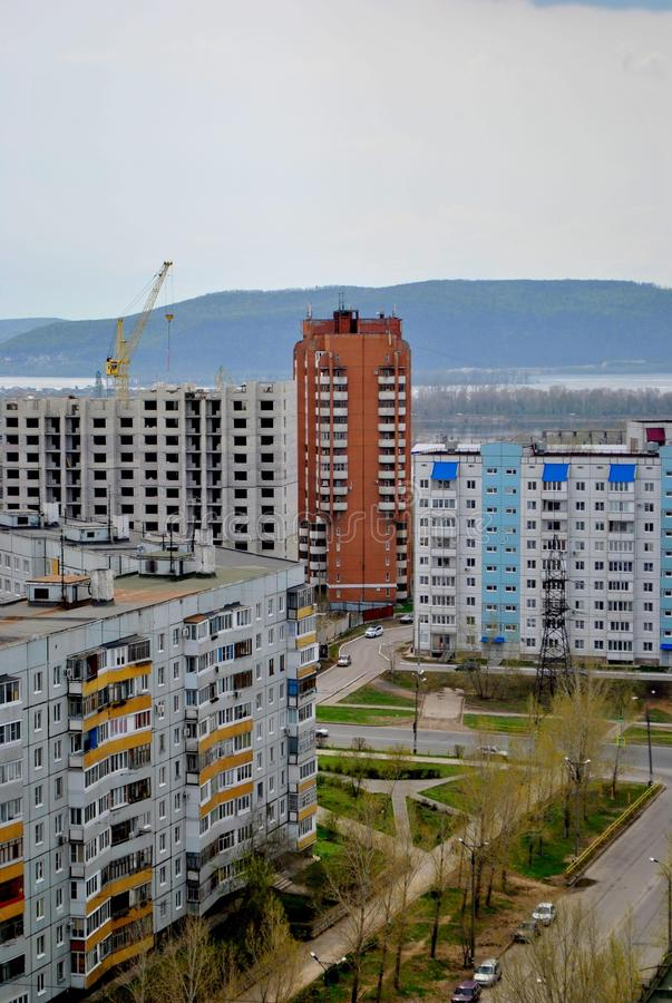 Morning spring view of residential buildings of the city and the Zhiguli mountains in the background. Morning spring view of residential buildings of the city royalty free stock photos