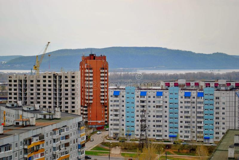 Morning spring view of residential buildings of the city and the Zhiguli mountains in the background. Morning spring view of residential buildings of the city royalty free stock images