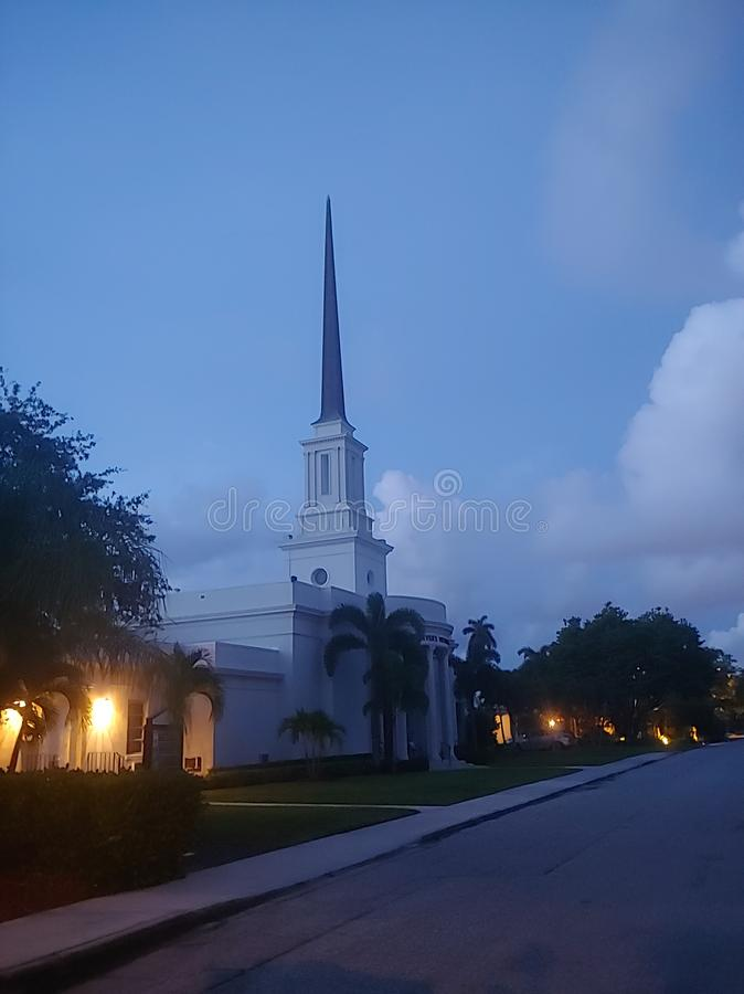 Morning steeple in the clouds stock photography