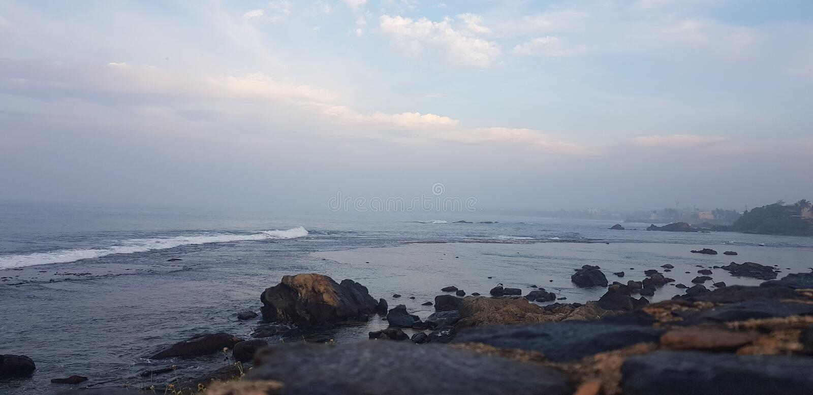 Morning stroll by the beach royalty free stock photo