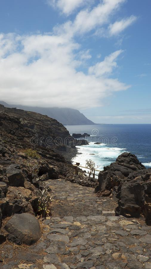 Vertical shot of the views towards western part of the island, with focus on the path to Charco Azul, El Hierro, Canary Islands royalty free stock images