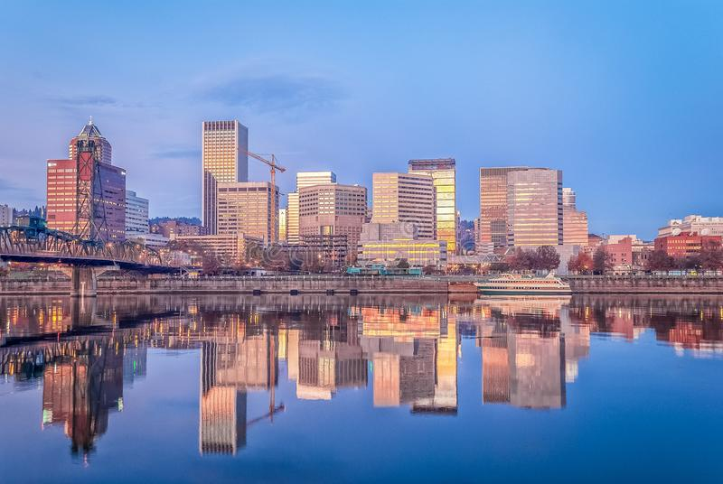 Early morning sun and blue sky greet the city royalty free stock images