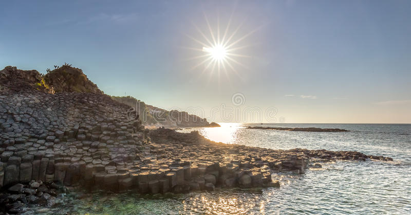 Morning sun on Giant Causeway stock image