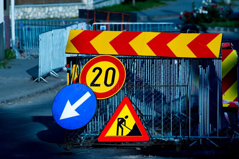 Morning sun illuminating the road construction street signs. On the street stock images
