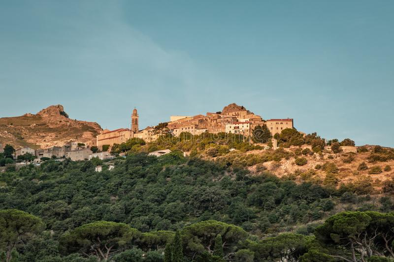 Morning sun on mountain village of Speloncato in Corsica. Early morning sun lighting up the buildings of the ancient mountain village of Speloncato in the royalty free stock image