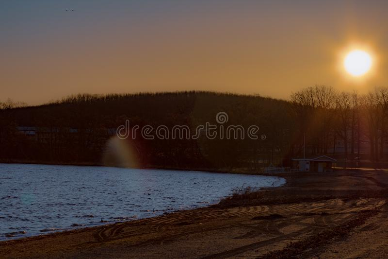 A winter beach at sunrise stock images