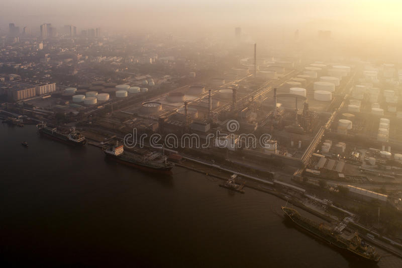 Morning Sunrise over petro chemical and oil refinery plant. Bangkok, Thailand royalty free stock image