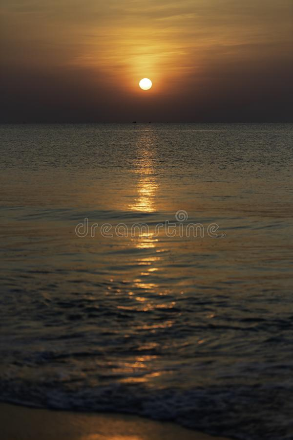 Morning with Sunrise in the sea and smooth wave of sea stock images