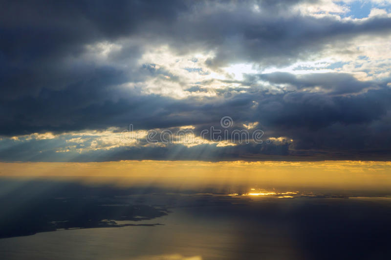 Morning sunrise with Wing of an airplane flying above the ocean. royalty free stock images