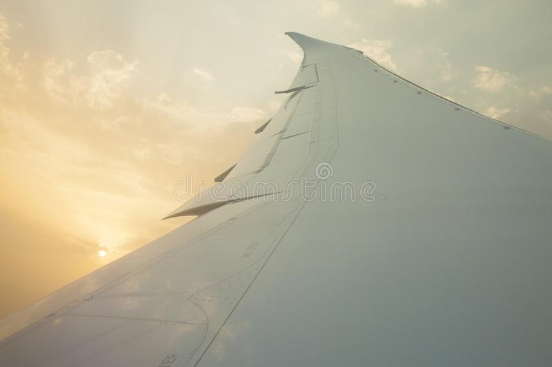 Morning sunrise with Wing of an airplane. Photo applied to tourism operators. picture for add text message or frame website. Trave stock photo
