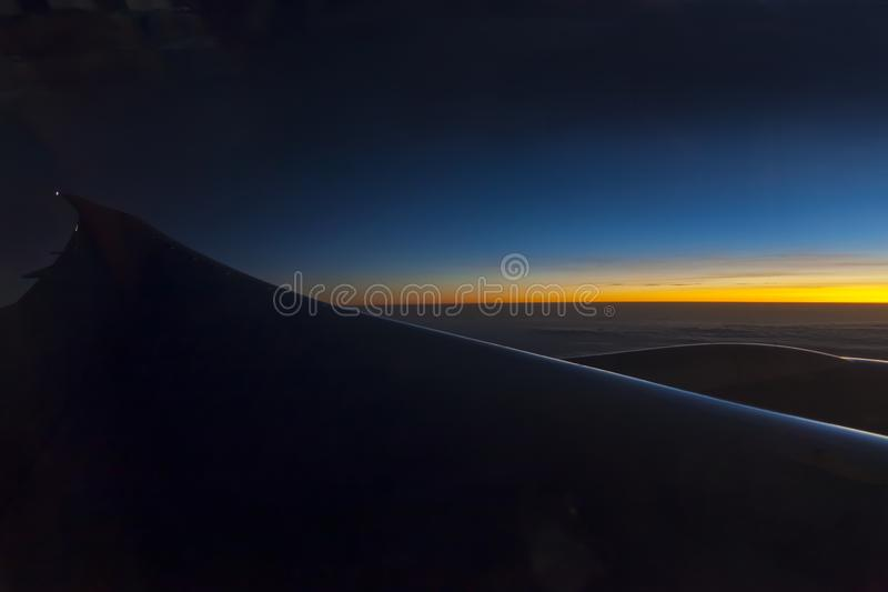 Morning sunrise with Wing of an airplane. Photo applied to tourism operators. picture for add text message or frame website. Trave royalty free stock image