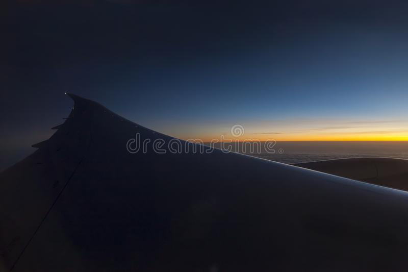 Morning sunrise with Wing of an airplane. Photo applied to tourism operators. picture for add text message or frame website. Trave stock photos