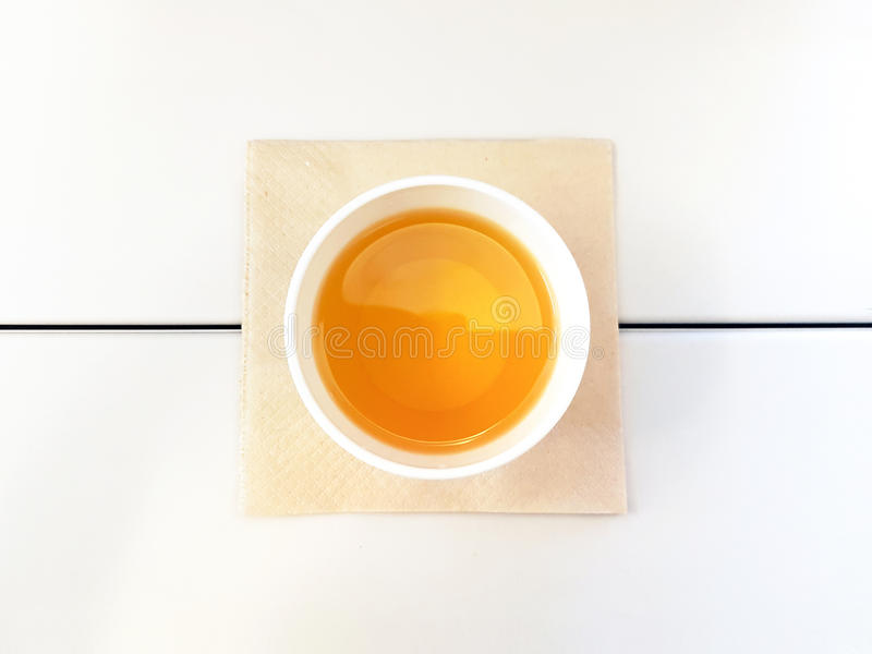 Morning Tea form Top View Like an Egg on the White Table with Brown Tissue royalty free stock image