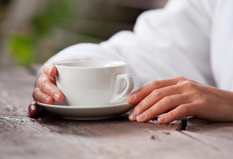 Morning time concept image. With woman hands and cup of tea stock images