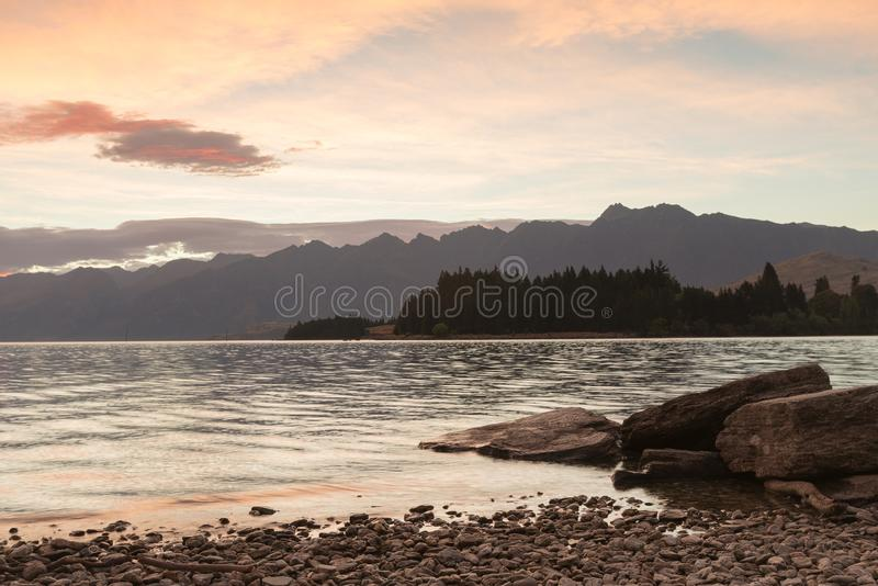 Morning tone at Wakatipu lake with mountain background, Queentown New Zealand stock photos
