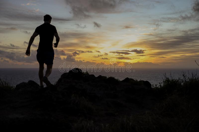 Morning trail run into the sunrise stock photography