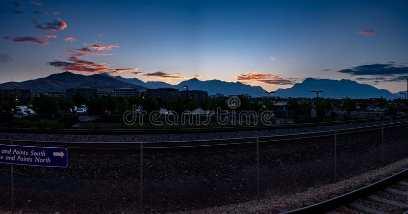 Morning at a train station with stunning clouds royalty free stock images