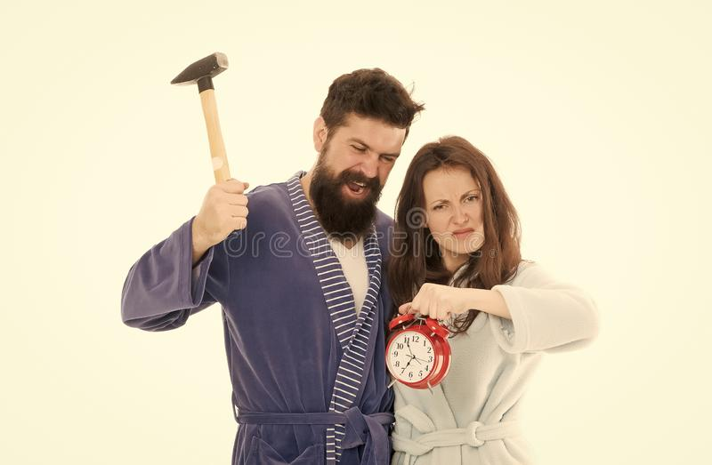 Morning tricks to set yourself up for much less stressful day. Lets get rid of this annoying alarm clock. Couple in. Bathrobes going to destroy alarm clock. Man royalty free stock image