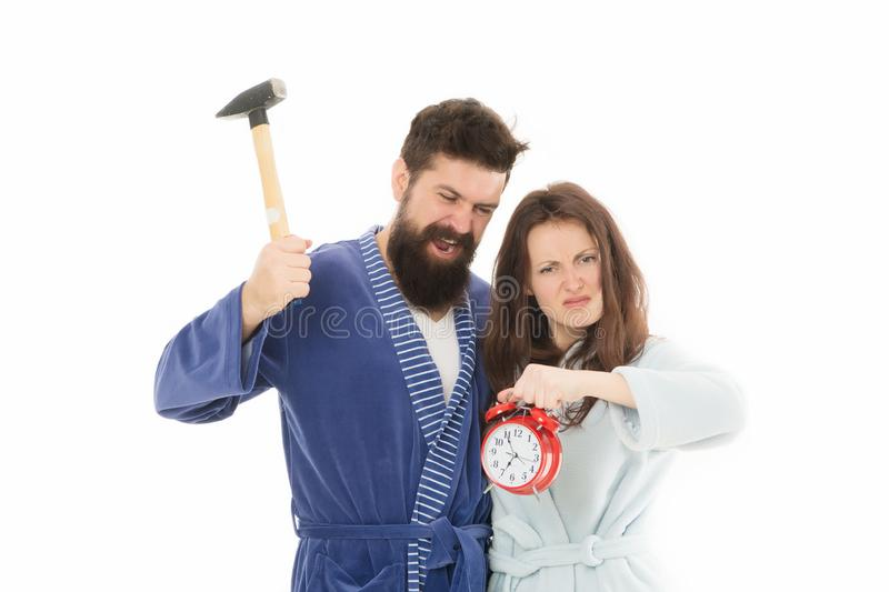 Morning tricks to set yourself up for much less stressful day. Lets get rid of this annoying alarm clock. Couple in. Bathrobes going to destroy alarm clock. Man stock images