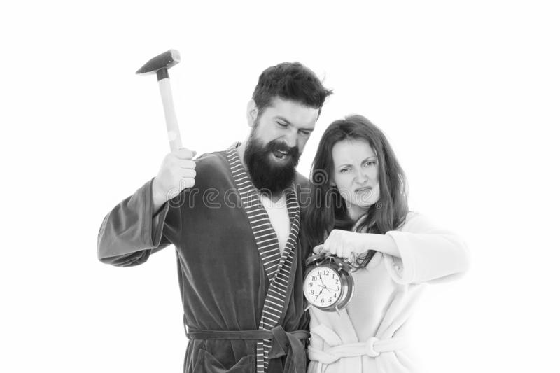 Morning tricks to set yourself up for much less stressful day. Lets get rid of this annoying alarm clock. Couple in royalty free stock photo
