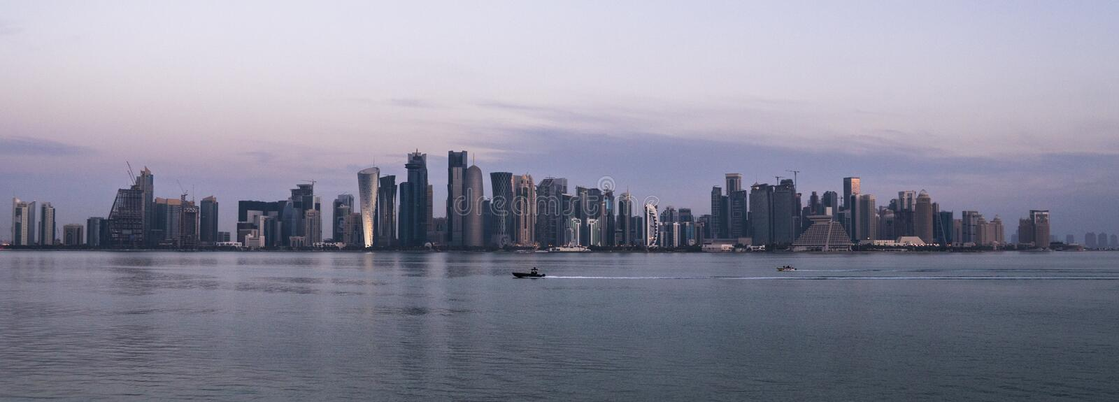 Morning Twilight Doha Skyline View. Qatar, Middle East. Persian Gulf royalty free stock images