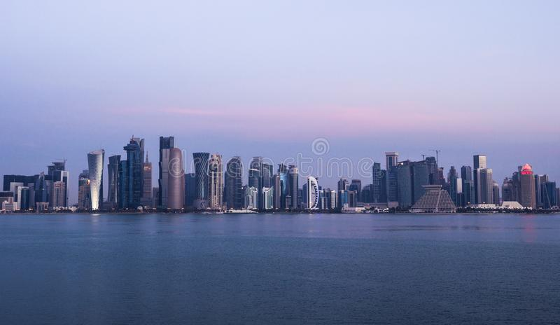 Morning Twilight Doha Skyline View. Qatar, Middle East. Persian Gulf royalty free stock photo