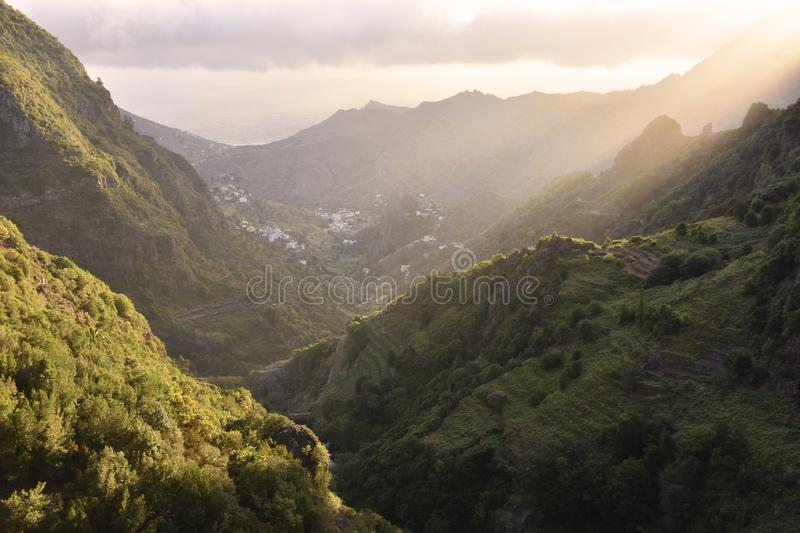 Morning valley of La Gomera Canary Islands. Hermigua Valley in the northeastern La Gomera Canary Islands Spain. Sunlight penetrates through clouds into the green stock image