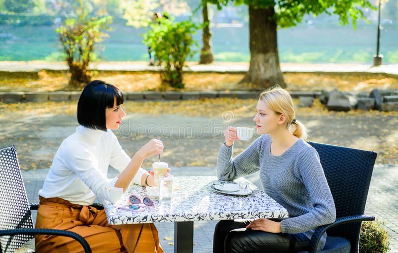 Morning vibes in cafe. female frienship. time to relax. bisiness meeting. summer cafe terrace. gossip concept. happy stock photography