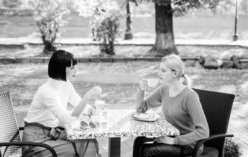 Morning vibes in cafe. female frienship. time to relax. bisiness meeting. summer cafe terrace. gossip concept. happy royalty free stock image
