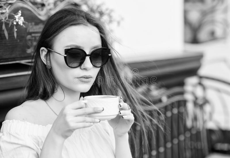 Morning vibes in cafe. summer fashion. Meeting in cafe. good morning. Breakfast time. stylish woman in glasses drink. Coffee. morning coffee. Waiting for date royalty free stock photos