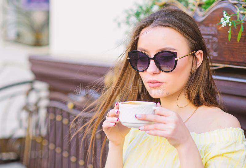 Morning vibes in cafe. summer fashion. Meeting in cafe. good morning. Breakfast time. stylish woman in glasses drink. Coffee. morning coffee. Waiting for date royalty free stock photography