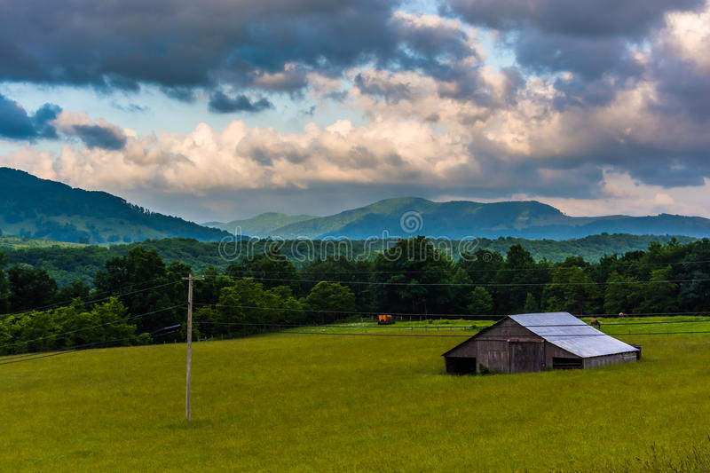 Morning view of a barn and distant mountains in the rural Potomac Highlands, West Virginia. stock image