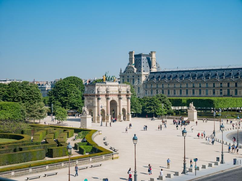 Morning view of the beautiful Arc de Triomphe du Carrousel at Paris. Paris, MAY 7: Morning view of the beautiful Arc de Triomphe du Carrousel at Paris on MAY 7 royalty free stock photos
