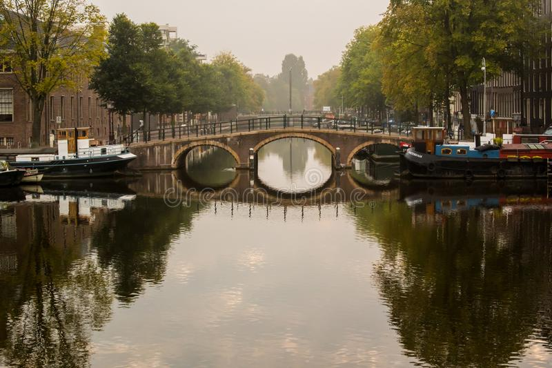 Morning view of canal bridge in Amsterdam stock image