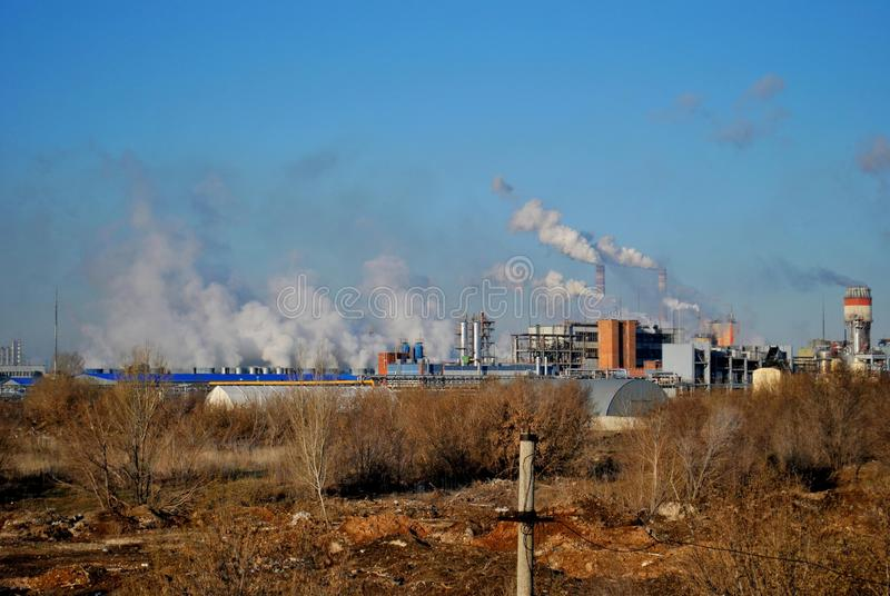 Morning view of chemical plants and smoking pipes in the industrial zone of the city. royalty free stock photos