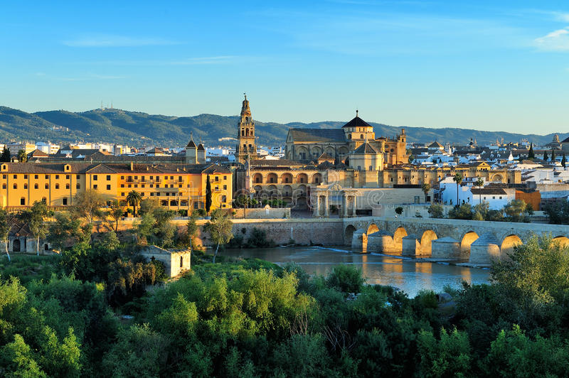 Morning view of Cordoba, Spain. Evening view of Mosque-Cathedral and Romano Bridge, Cordoba,Spain stock photography