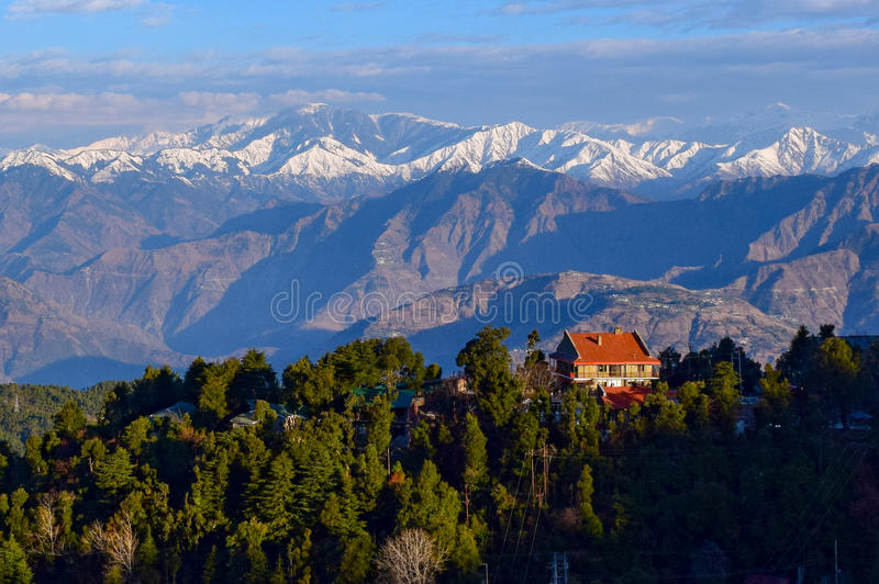 Morning view of Dalhousie town during winter morning. Dalhousie a beautiful town of himachal pradesh. Snow covered pir panjal range of himalaya can be seen in royalty free stock image