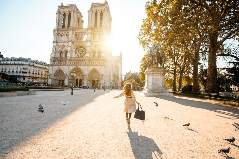 Woman on th esquare near Notre-Dame cathedral in Paris stock image