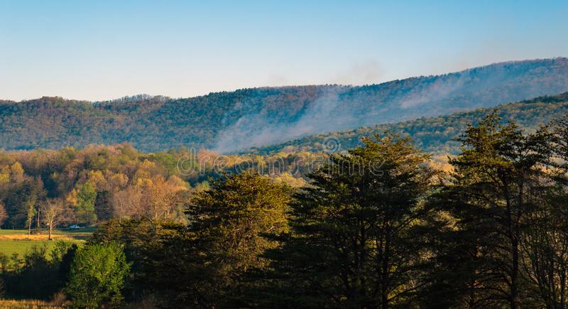 Morning View of a Forest Fire on Catawba Mountain royalty free stock images