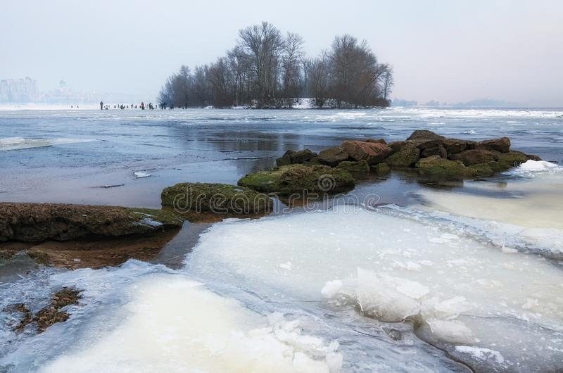 Morning view of Obolon district in Kyiv, Ukraine. A dangerous hobby - winter fishing. stock photo