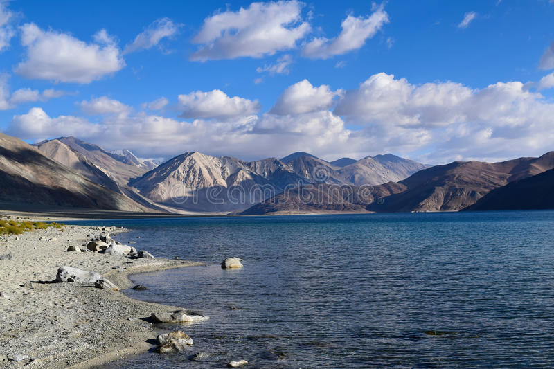 Morning view of Pangong lake with himalyan mountain range in background in Leh. Mesmerizing beauty of pangong lake with its shore on morning. Lake is situated at royalty free stock photography