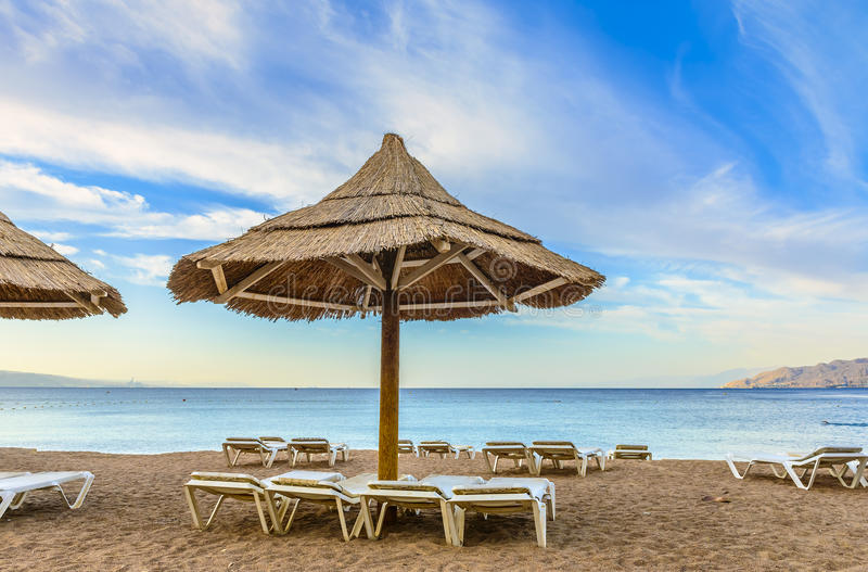 Morning view on the Red sea, Eilat. Sandy beach of Eilat - famous resort and tourist city in Israel royalty free stock image