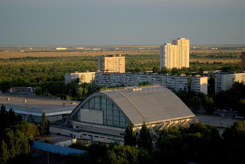"Morning view of the universal sports complex ""Olympus"" and new buildings on Sportivnaya street. Togliatti, Samara region, Russia - August 14, 2018 royalty free stock image"